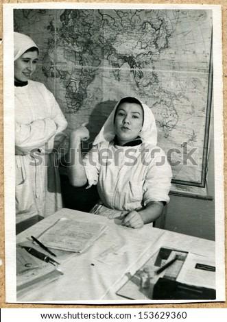 UKRAINE - CIRCA 1957: An antique photo shows Two young women is nurses Oncology Center, Vorochilovgrad, now Lugansk, Ukraine, 1957