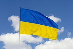 Ukraine flag isolated on the blue sky with clipping path. close up waving flag of Ukraine. flag symbols of Ukraine.