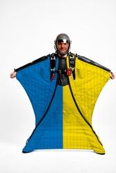 Ukraine flag travel. Bird Men in wing suit flag. Sky diving men in parashute. Patriotism, men and flag.