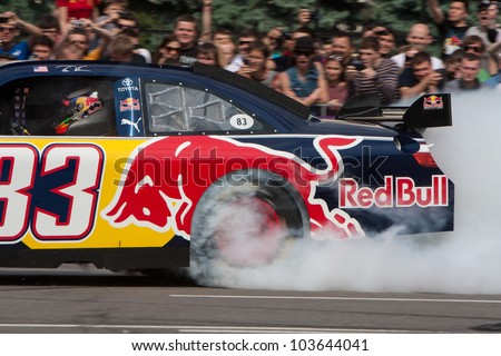 UKRAINE,KIEV - MAY 19: Daniel Ricciardo drive a NASCAR of Red Bull Racing Fires Up the Streets of Kiev making even more smoke and noise, Champions Parade, May 19, 2012 in Kiev, Ukraine