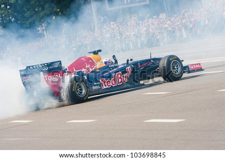 UKRAINE,KIEV - MAY 19: Scuderia Toro Rosso driver Daniel Ricciardo drive the RB7 of Red Bull Racing Fires Up the Streets of Kiev, Champions Parade, May 19, 2012 in Kiev, Ukraine