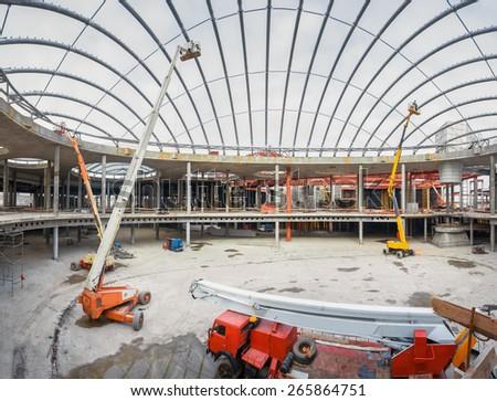 UKRAINE, KIEV - OCT 12: The work of construction machinery. Progress in the construction of shopping mall Republic on October 12, 2013 in Kiev, Ukraine.