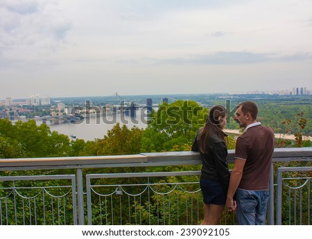 UKRAINE, KIEV - September 9,2013: Couple in love looking at the panorama of Kiev, Ukraine
