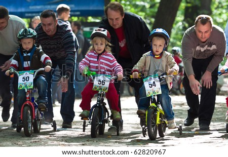 UKRAINE, KIEV - SEPTEMBER 11: Young bikers, at the child amateur bicycle competition We are the champions, on September 11, 2010 at Ukraine, Kiev.
