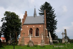Ukraine, Komarno - neo-gothic brick chapel from the end of the 19th century at the Polish cemetery