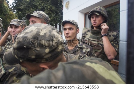 UKRAINE, KYIV - 29 Aug, 2014: Military personnel hold the gate of the Ministry of Defense of Ukraine, hundreds of protesters demanded the purge in the Ministry of Defence.
