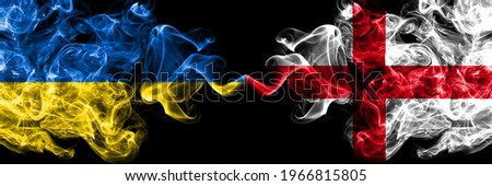 Ukraine, Ukrainian vs England, English smoky mystic flags placed side by side. Thick colored silky abstract smokes flags. Foto stock ©