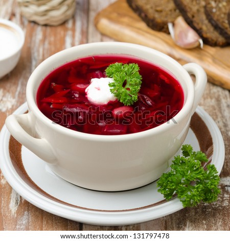 Ukrainian and russian national red borsch with sour cream closeup