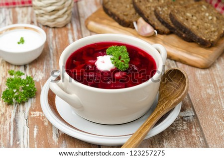Ukrainian and russian national red borsch with sour cream on the table horizontal