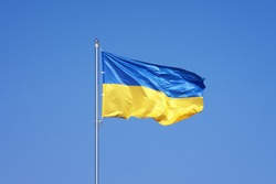 Ukrainian flag on blue sky backgroud