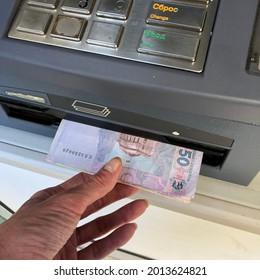 Stock photo Ukrainian  money  from bank terminal.  Ukrainian hryvnia money  cash