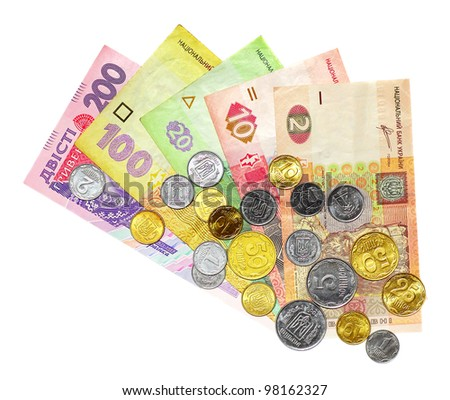 Ukrainian money called hryvnya with coins on top of them isolated on white background