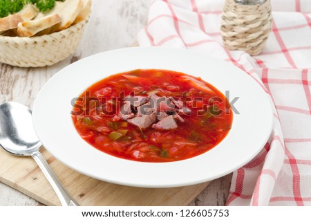ukrainian national red borscht on the white plate, top view