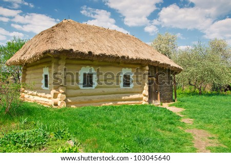 ukrainian old log hut in a garden