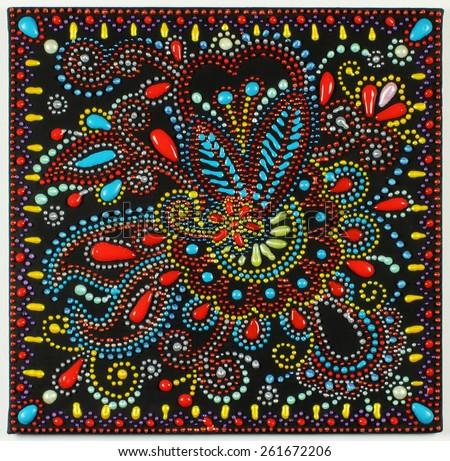 ukrainian traditional art point painting on black background, handmade artwork with decorative flower