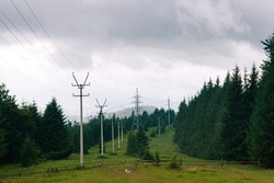 Ukrainian village in the Carpathian mountains in overcast day. Country side view of cloudy vertex in the middle of summer. Rural landscape with forest, hills, meadow without people.