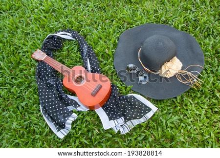 ukulele&black hat on backyard,music,summer