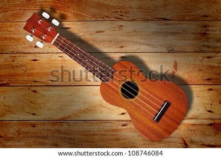 ukulele on Old wood wall texture background