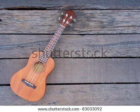 ukulele on old wooden - stock photo