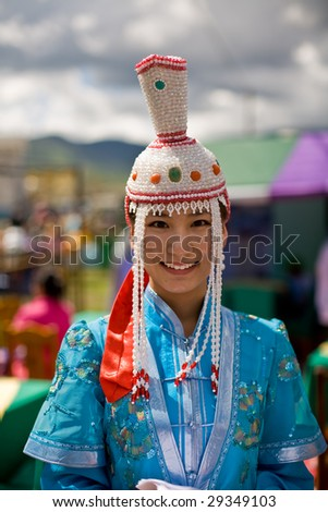 ULAN BATOR, MONGOLIA - JULY 11:  Mongolian Woman wears a traditional ethnic dress during the Nadaam National Games. July 11, 2008 Ulan Bator, Mongolia