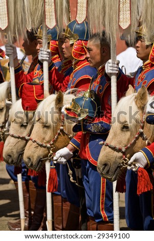 ULAN BATOR, MONGOLIA - JULY 11: Traditional Mongolian cavalry color guard begins Nadaam National Games by delivering nine ceremonial white yak tails to the stadium. July 11, 2008 Ulan Bator, Mongolia
