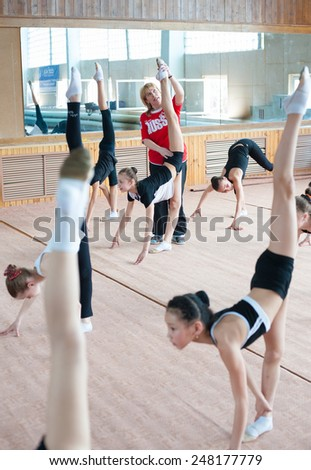ULAN-UDE, RUSSIA - APRIL 28, 2011: Trainer Svetlana Bogatykh coaches girls in Gratsia rhythmic gymnastics studio, City Palace of Childrens Arts, the biggest centre offering childrens hobby circles.