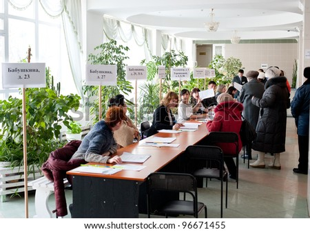 ULAN-UDE, RUSSIA - MARCH 4: The divisional election committee 699 of Burytia Republic register voters at the presidential election of Russian Federation on March 4, 2012 at a local polling station in Ulan-Ude, Russia.