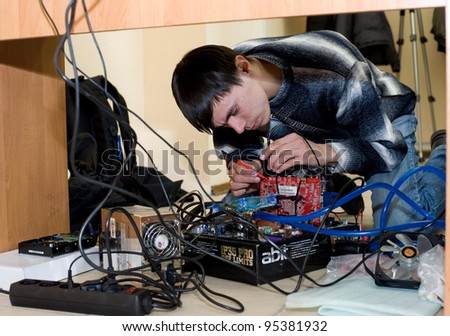 ULAN-UDE, RUSSIA - MARCH 28: The 1st Open City Overclocking Contest. A participant measures the voltage of a video adapter, March, 28, 2010 in Ulan-Ude, Buryatia, Russia.