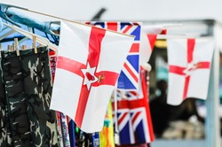 Ulster parliament (defunct) flags and Union flags on sale at a market stall