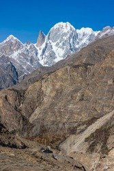 Ultar Sar mountain and Lady Finger mountain peak in Hunza valley in autumn season, Gilgit Baltistan, Pakistan, Asia