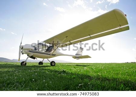 Ultra-light aircraft against sunlight
