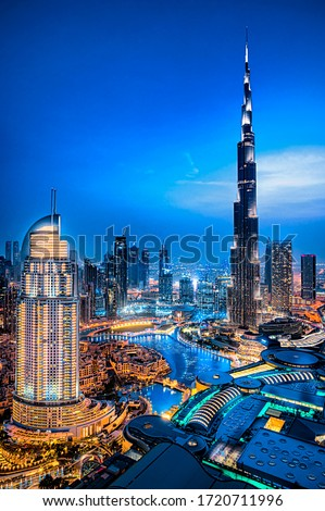 Ultra modern city of Dubai. Night view of Downtown. Tall buildings. Luxury travel concept.