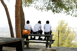 Ultra Orthodox boys sitting on a table watching the landscape
