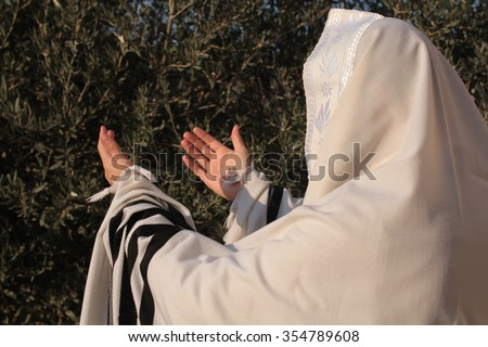 Ultra Orthodox Jewish man praying in the forest in the morning. Jewish men pray morning prayer called Shacharis every day as observed