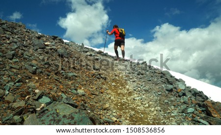 Ultra trail running, sport activities, mountain trails marathon. The concept for exercising and healthy lifestyle.