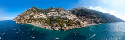 Ultra wide aerial panorama view of Amalfi coast. Background. Rocky shores and incredible beaches, Luxury yachts, boats and apartments overlooking Tyrrhenian Sea. Bright sunny day. Positano, Italy