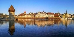Ultra wide panorama of Luzern with house reflected in the Reuss River