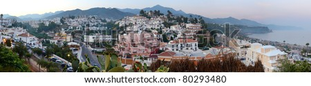 Ultra wide panorama of the picturesque tourist resort of Nerja on Andalucia's Mediterranean coast
