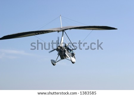 Ultralight taking off from an unmanned airfield in the early morning.