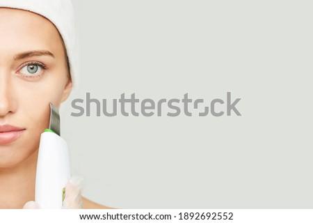 Ultrasonic skin equipment. Woman face cosmetology treatment. Female clinic facial procedure. Anti acne surgery cleaning. Dermatology spa mask. Detox therapy. Rejuvenation skincare beauty. Copyspace Stok fotoğraf ©