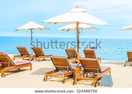 Umbrella and beach chair with beautiful tropical beach - summer vacation background #326488706