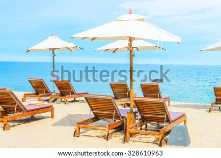 Umbrella and beach chair with beautiful tropical beach - summer vacation background #328610963