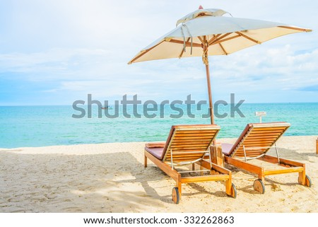 Umbrella and beach chair with beautiful tropical beach - summer vacation background - Shutterstock ID 332262863