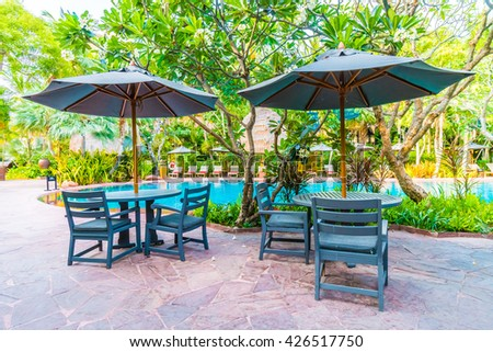 Comfortable Chair At The Swimming Pool, Modern Chair, Umbrella And Pillow  Brown Color. | EZ Canvas