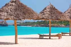 Umbrella and lounges at the shore of Indian Ocean, Kendwa beach, Zanzibar, Tanzania