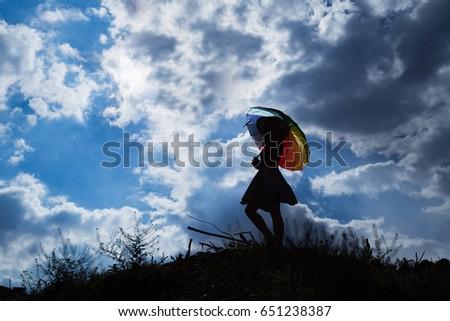 umbrella and pretty girl silhouette background