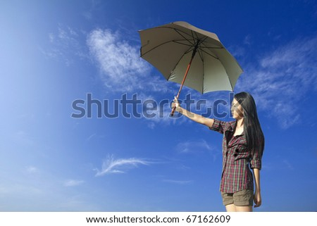 umbrella and woman in blue sky
