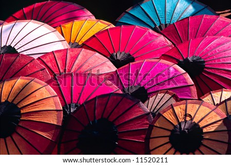 stock photo : Umbrella at a tipical market, Luang Prabang,  Laos.