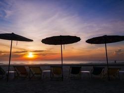 umbrella, chair, silhouette on the beach