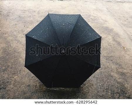 Umbrella in the rain #628295642